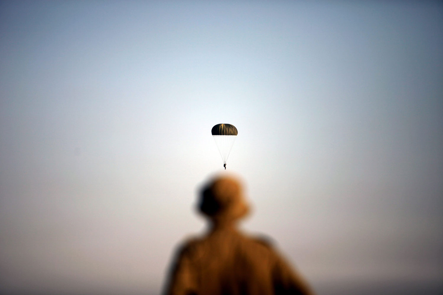 September 13, 2011. Israeli army paratroopers take part in a training jump in full battle gear over the Palmachim military base near Tel Aviv, Israel. Although the Paratroopers Brigade has had only one operational combat parachute drop ever, during the 1956 Sinai War, volunteers accepted into the elite unit undergo operational training jumps with all the equipment needed for battle.