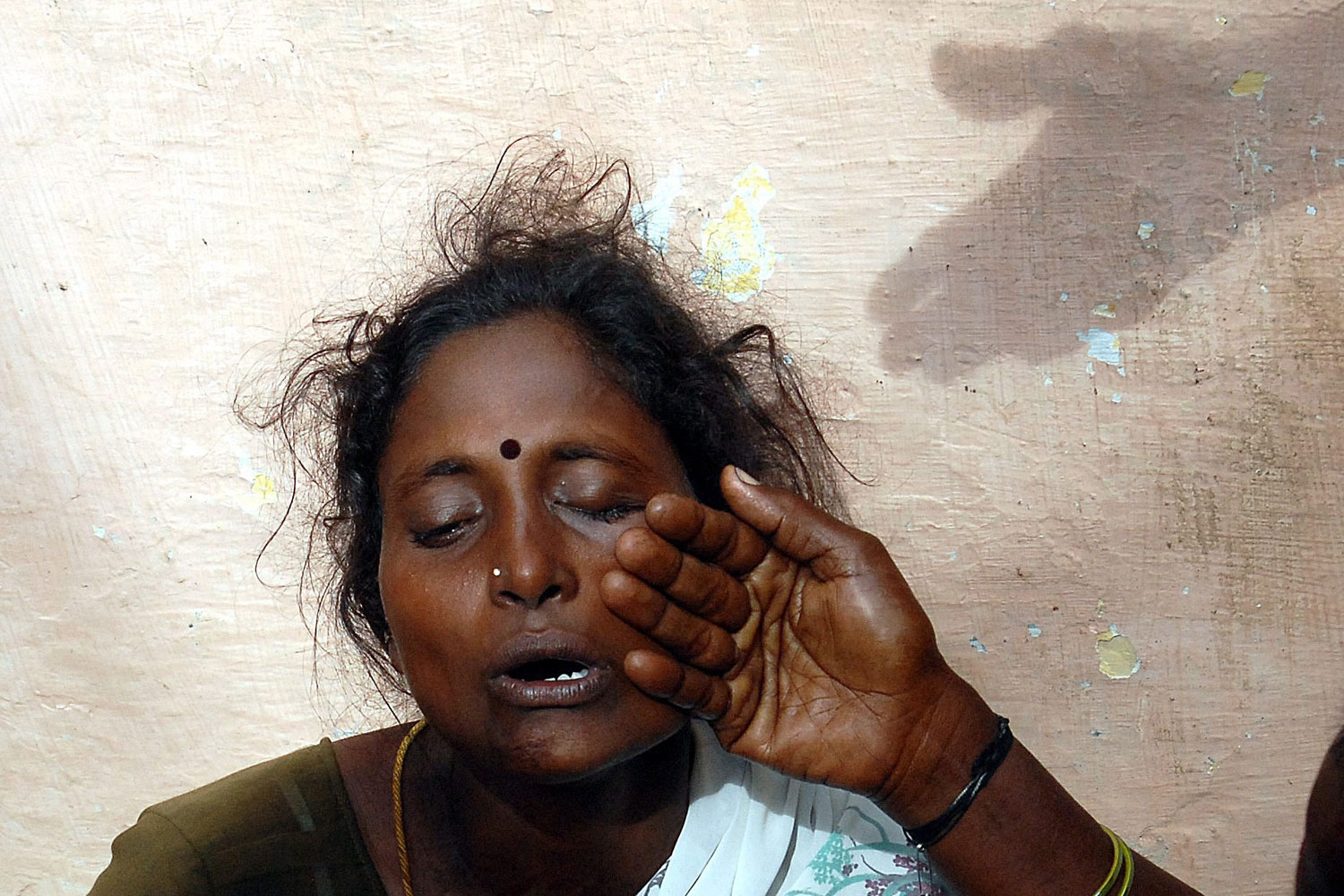 September 14, 2011. An Indian relative of a victim of the train accident at the Chitheri station is consoled as she cries outside the Arakkonam Government Hospital, 90kms from Chennai, India. At least nine people died and more than 100 injured after a passenger train crashed into a stationary train, late September 13. Accidents are common on India's vast rail network, on which more than 13 million passengers travel each day.