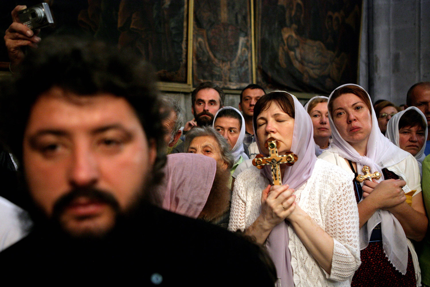 September 27, 2011. A Christian woman kisses a wooden cross during exaltation of the Holy Cross ceremony, the feasts of the Cross which commemorate the cross used in the crucifixion of Jesus, at the Church of the Holy Sepulchre in Jerusalem, Israel.