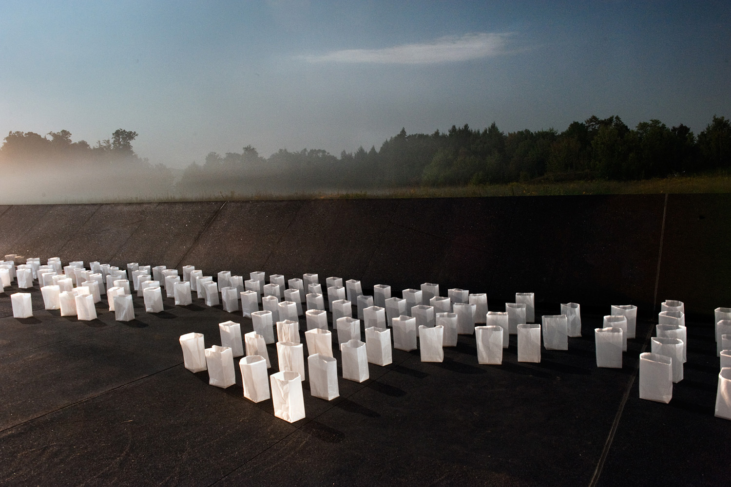 Extinguished luminaries sit along the Flight 93 National Memorial in Shanksville, Pa., Sept. 10, 2011.