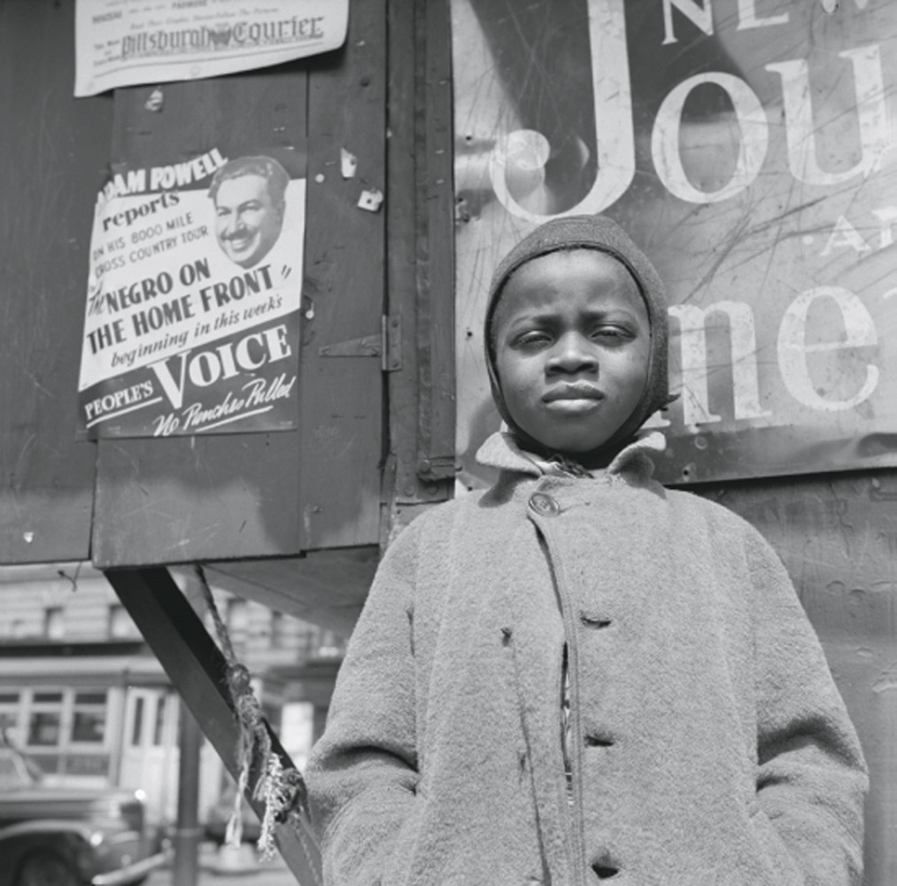 A Harlem newsboy in New York City, May or June 1943.