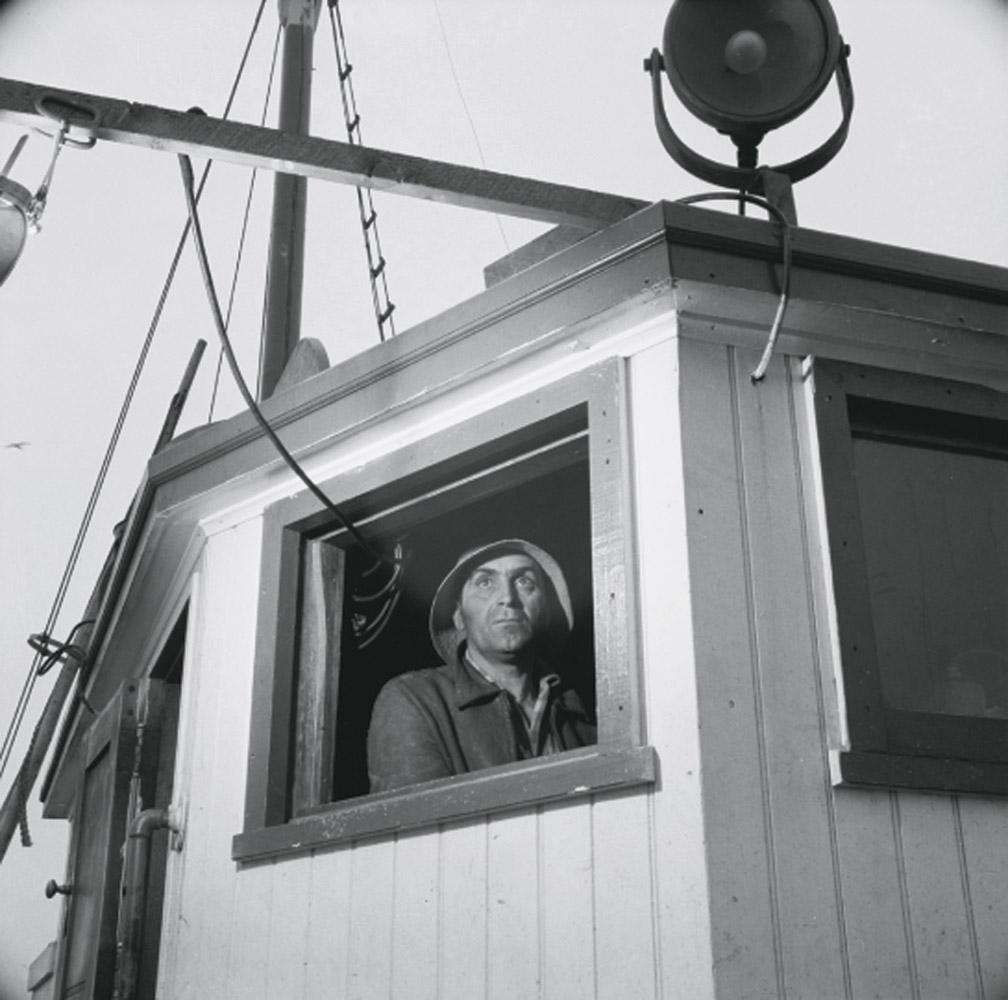 Lorenzo Scola maneuvers a ship during mackerel chase in Gloucester, Massachusetts, June 1943.