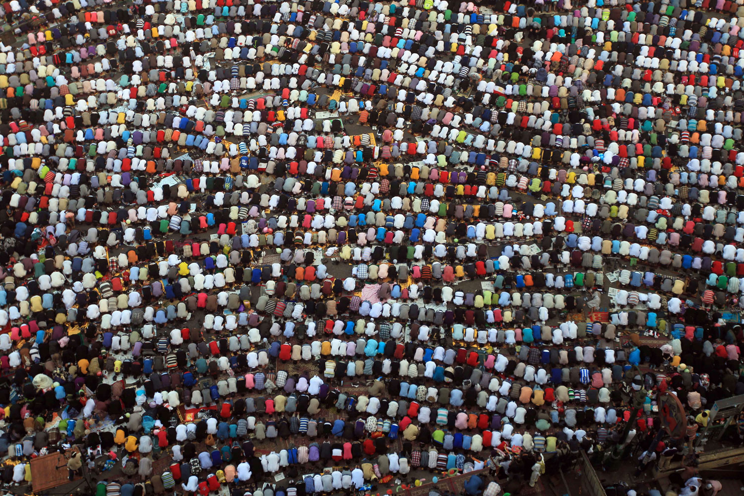August 30, 2011. Thousands of Muslims gather in Tahrir Square in Cairoto pray and mark 'Id al-Fitr, the end of fasting during Ramadan. The 'Id was the first since revolutionaries demonstrating in the square deposed Egyptian President Hosni Mubarak in February and triggered similar protests against dictators throughout the Arab world.