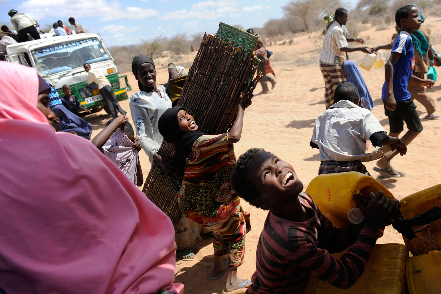 August 29, 2011. Refugees in Hagadera, Kenya, scramble to load their belongings onto trucks that will relocate them to a newly opened camp near Nairobi. About a thousand new refugees fleeing famine in Somalia continue to pour into Kenya each day.