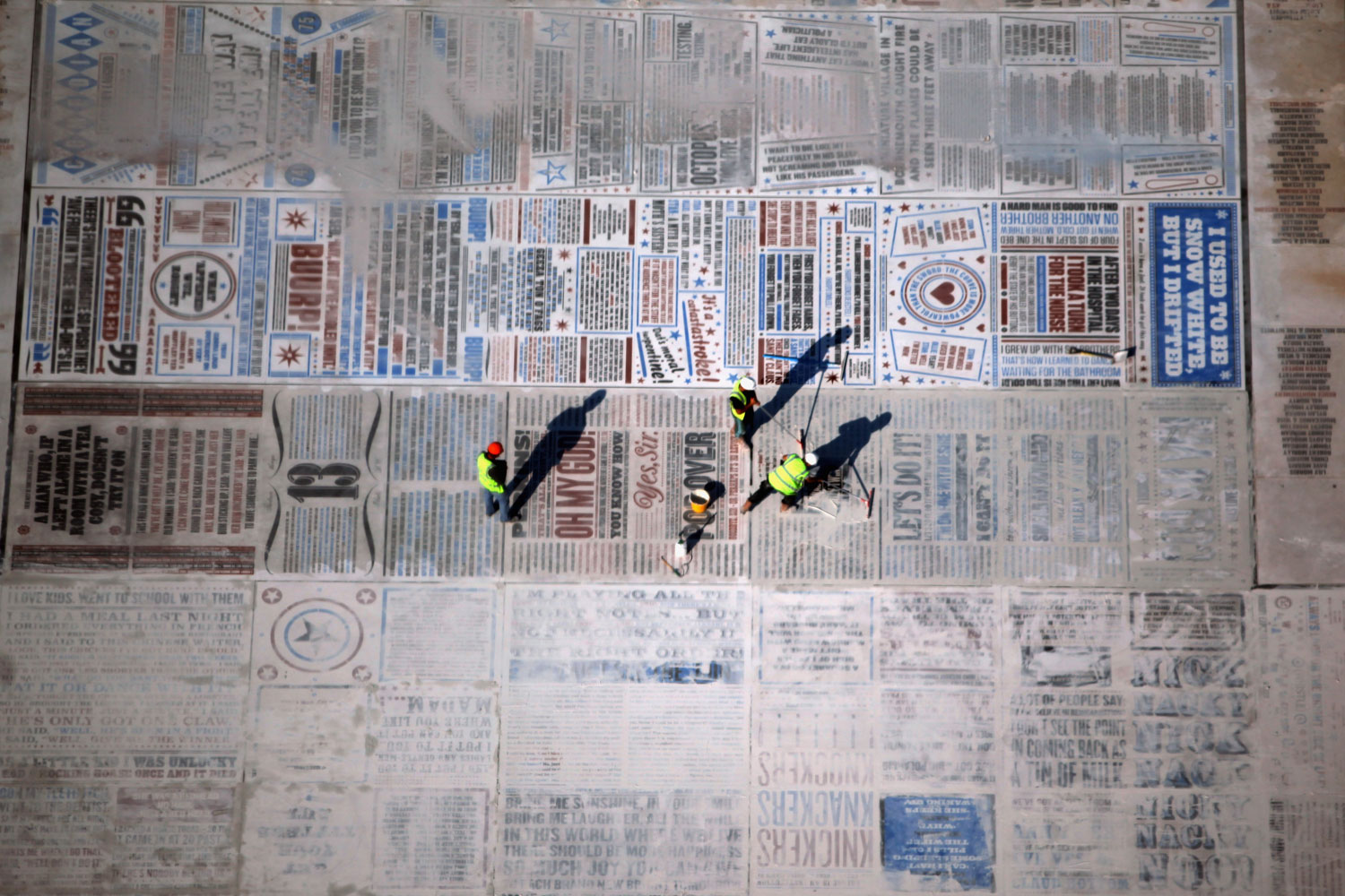 September 1, 2011. Workmen put the finishing touches to a giant art work on Blackpool promenade viewed fron the top of the refurbished Blackpool Tower in Blackpool, England.