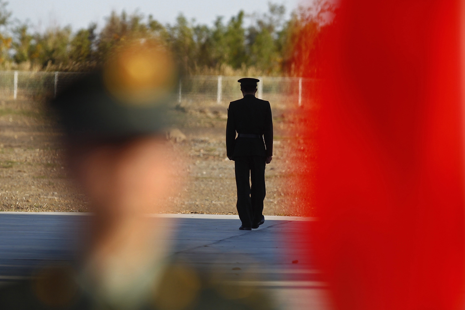 September 28, 2011. Chinese soldiers guard Long March II-F rocket loaded with China's unmanned space module Tiangong-1 (not in the picture) at the launch pad in the Jiuquan Satellite Launch Center, Gansu province, China. China will launch an experimental craft paving the way for its first space station, bringing the growing Asian power closer to matching the United States and Russia with a long-term manned outpost in space.