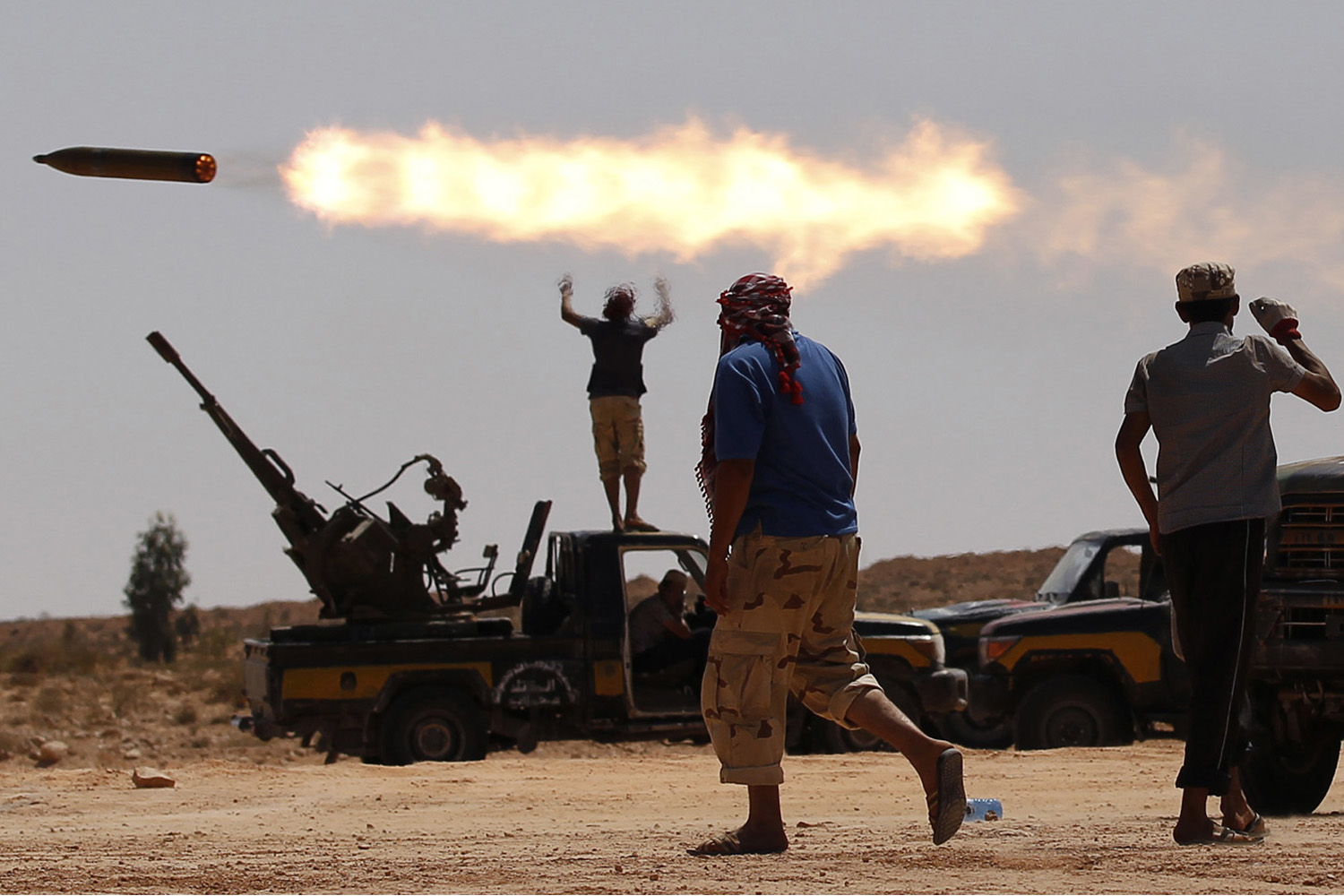 September 24, 2011. Anti-Gaddafi fighters fire a multiple rocket launcher near Sirte, one of Muammar Gaddafi's last remaining strongholds. Libyan provisional government forces backed by NATO warplanes swarmed into the city of Sirte but weathered heavy sniper fire as they tried to win control of one of deposed leader Muammar Gaddafi's last bastions of support.