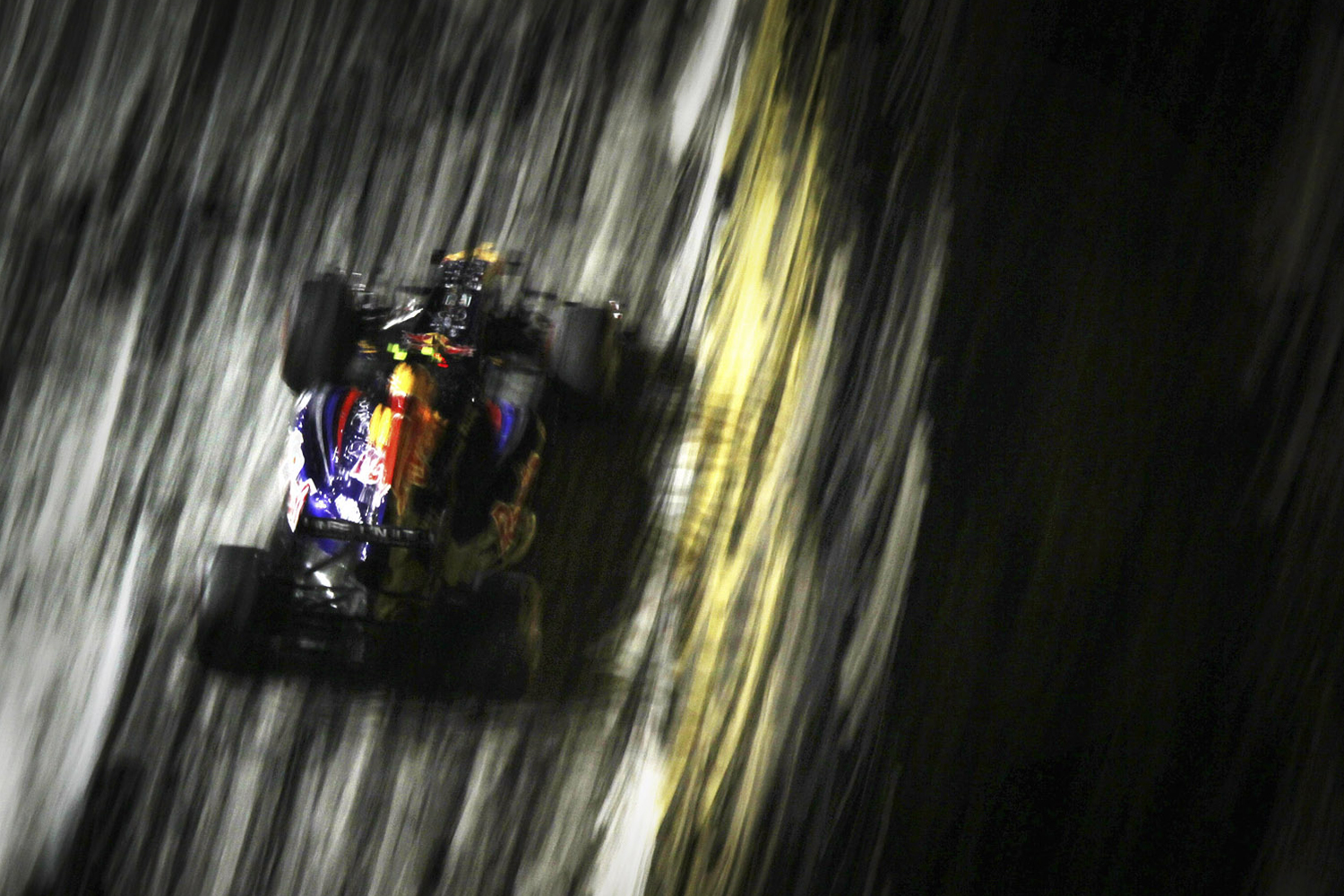 September 24, 2011. Red Bull driver Sebastian Vettel of Germany steers his car on this way to getting the pole position during the qualifying session for Singapore Formula One Grand Prix on the Marina Bay City Circuit in Singapore.
