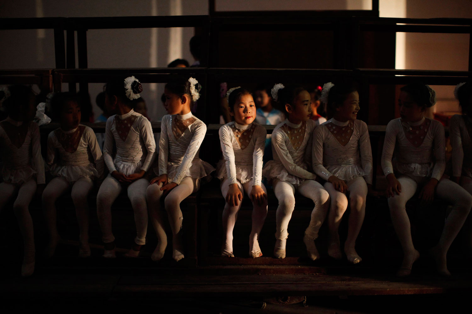 August 29, 2011. Girls sit backstage before their performance at a local school in Rason city, northeast of Pyongyang.