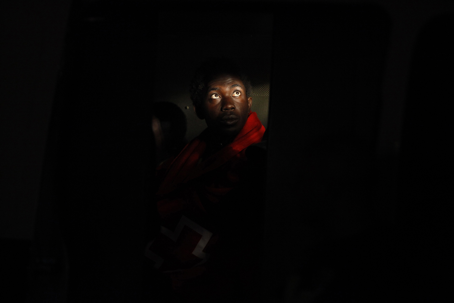 September 23, 2011. A would-be immigrant sits inside a police van after arriving at the port in Malaga, southern Spain. Some 44 would-be immigrants, including two women aboard a zodiac were intercepted off the southern Spanish coast as they were heading to European soil from Africa.