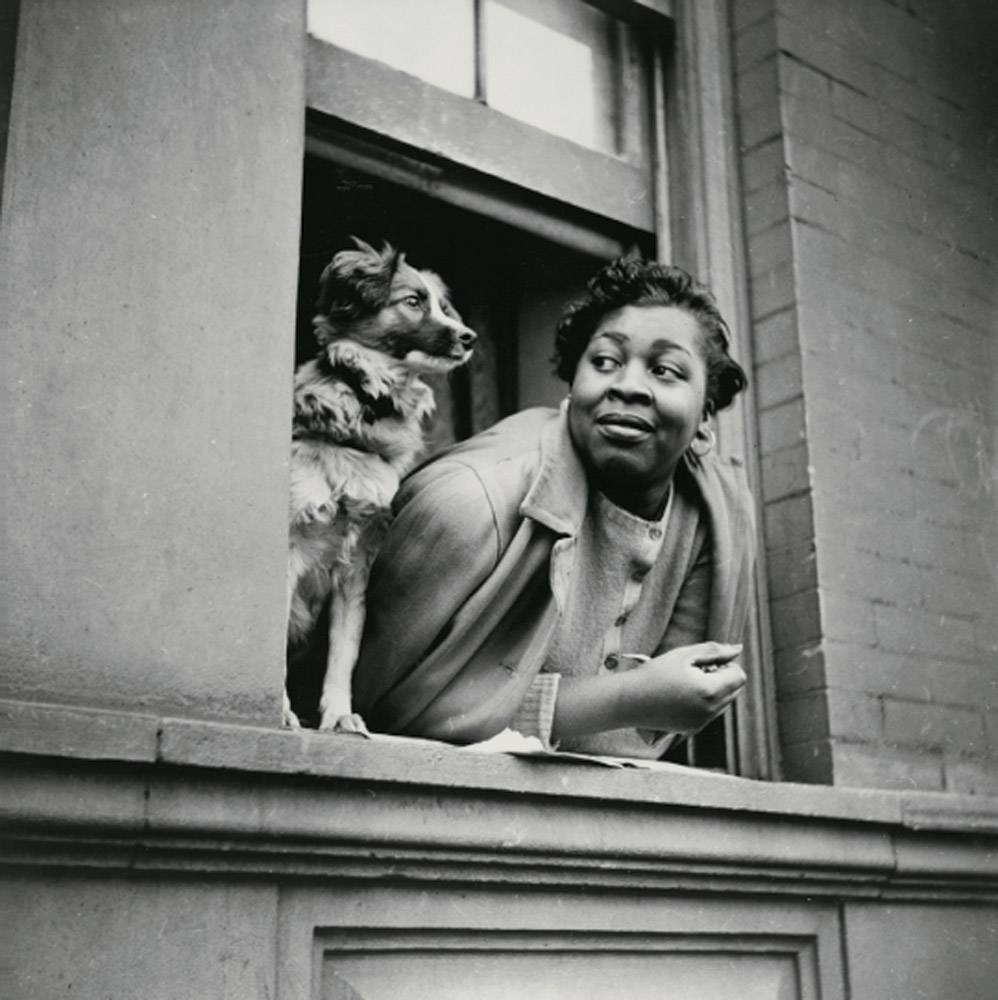 A woman and her dog in Harlem, New York City, May 1943.