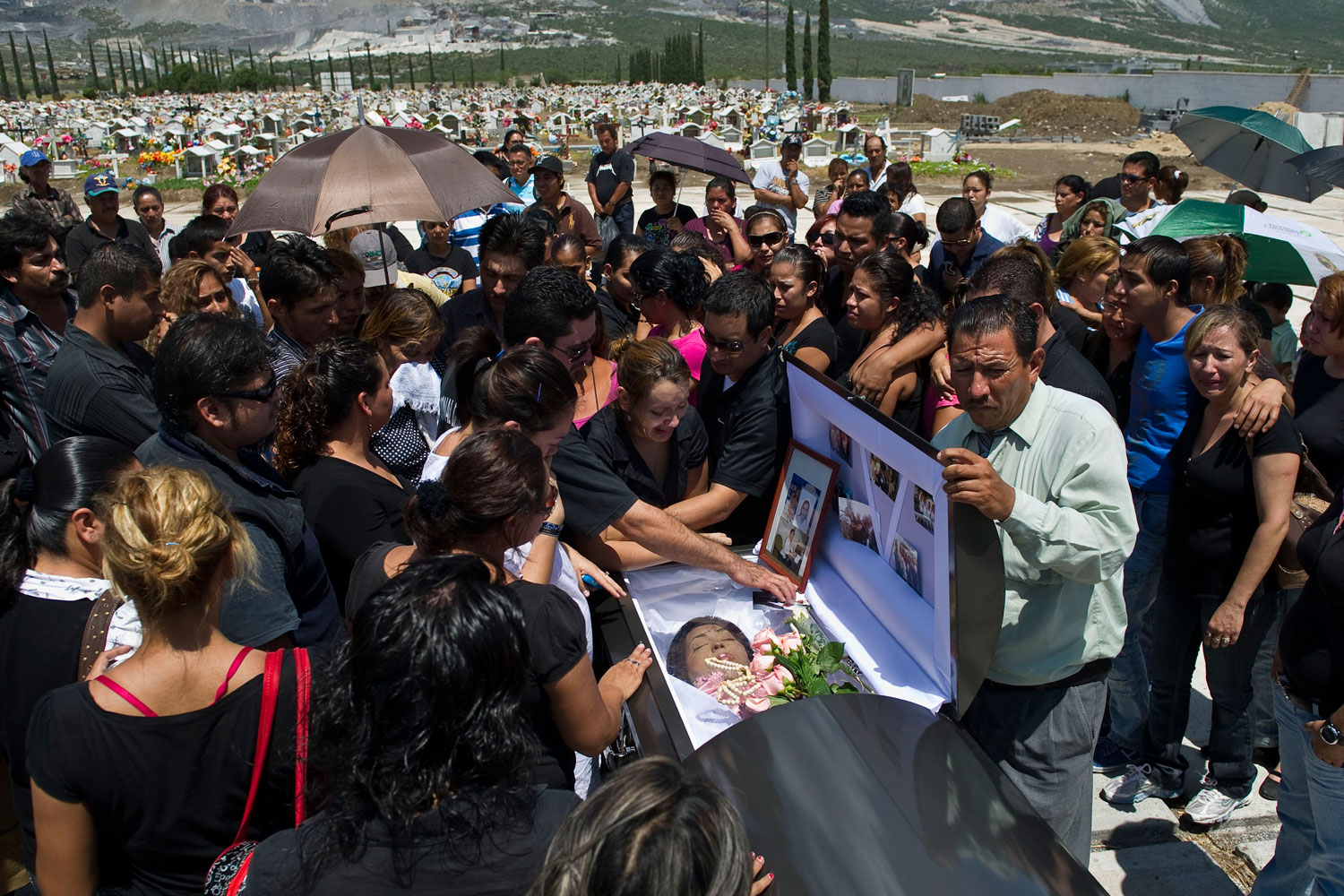August 27, 2011. Relatives and friends of Maria Guadalupe Monsivais --one of the 52 victims of the Casino Royale fire-- mourn next to her coffin, during the wake in Monterrey, Mexico. Mexico offered a reward Friday of $2.4 million for information leading to the arrest of armed men who torched the casino on August 25, leaving 52 people to burn and choke to death in a blazing inferno. The particularly callous attack shocked a nation routinely used to grim murders and high tolls in a drugs war that has claimed more than 41,000 lives since Calderon launched a military crackdown in 2006.