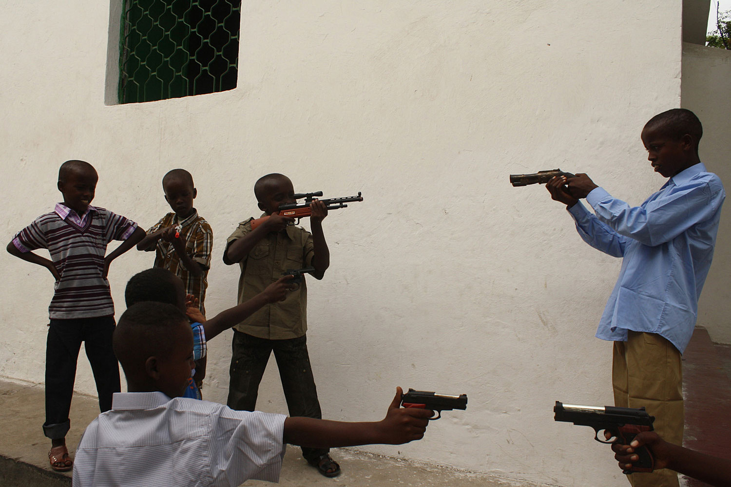 August 30, 2011. Somali children play with toy guns and weapons in Mogadishu at the start of the three-day Eid al-Fitr feast. Eid-al-Fitr celebrations mark the end of the fasting Muslim month of Ramadan