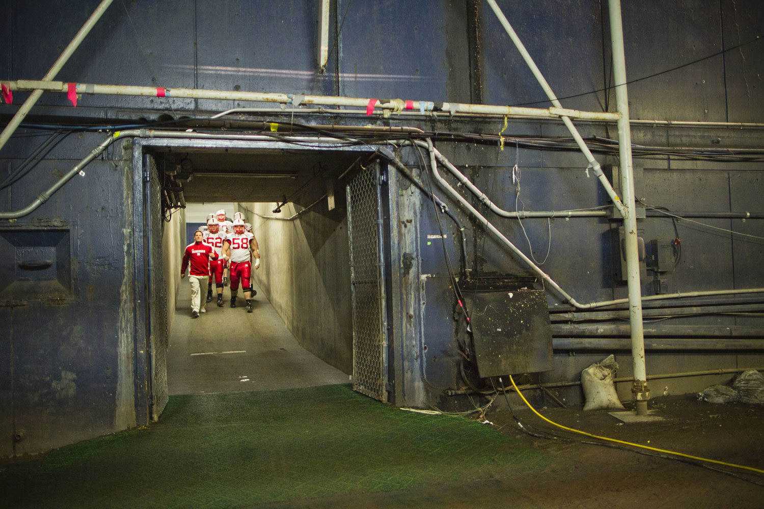 Husker offensive linemen enter the field before the Holiday Bowl in San Diego to play the University of Washington in December 2010.
