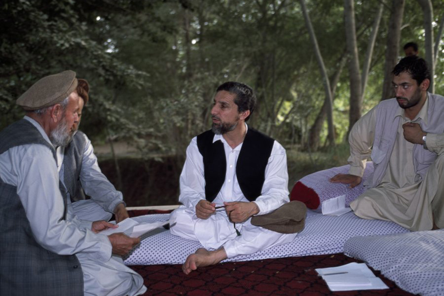 Afghan opposition leader Ahmed Shah Massoud (center) meets with his advisors at one of his headquarters in Khwaja Bahauddin, Badakhshan Province, Afghanistan. June 2001