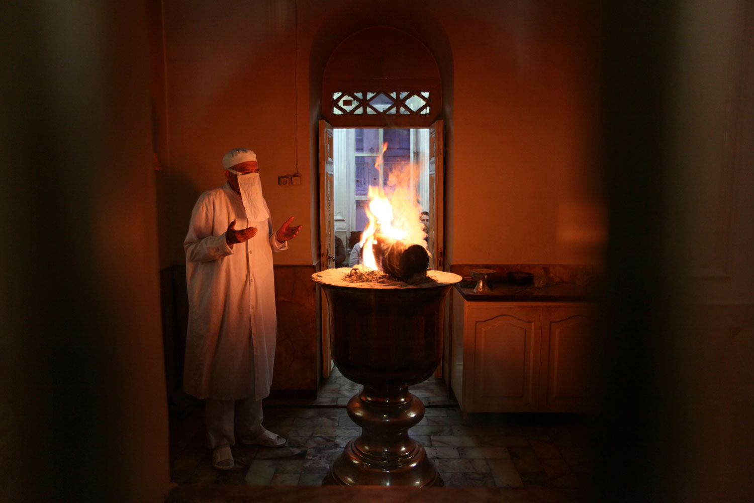 September 12, 2011. An Iranian Zoroastrian priest, performs a ritual at a fire temple in Tehran, Iran. Zoroastrians are recognized in the Iranian constitution as religious minorities who have their own lawmaker in parliament. Zoroastrianism lost dominance in Iran after Muslim Arabs conquered Persia in the 7th century.