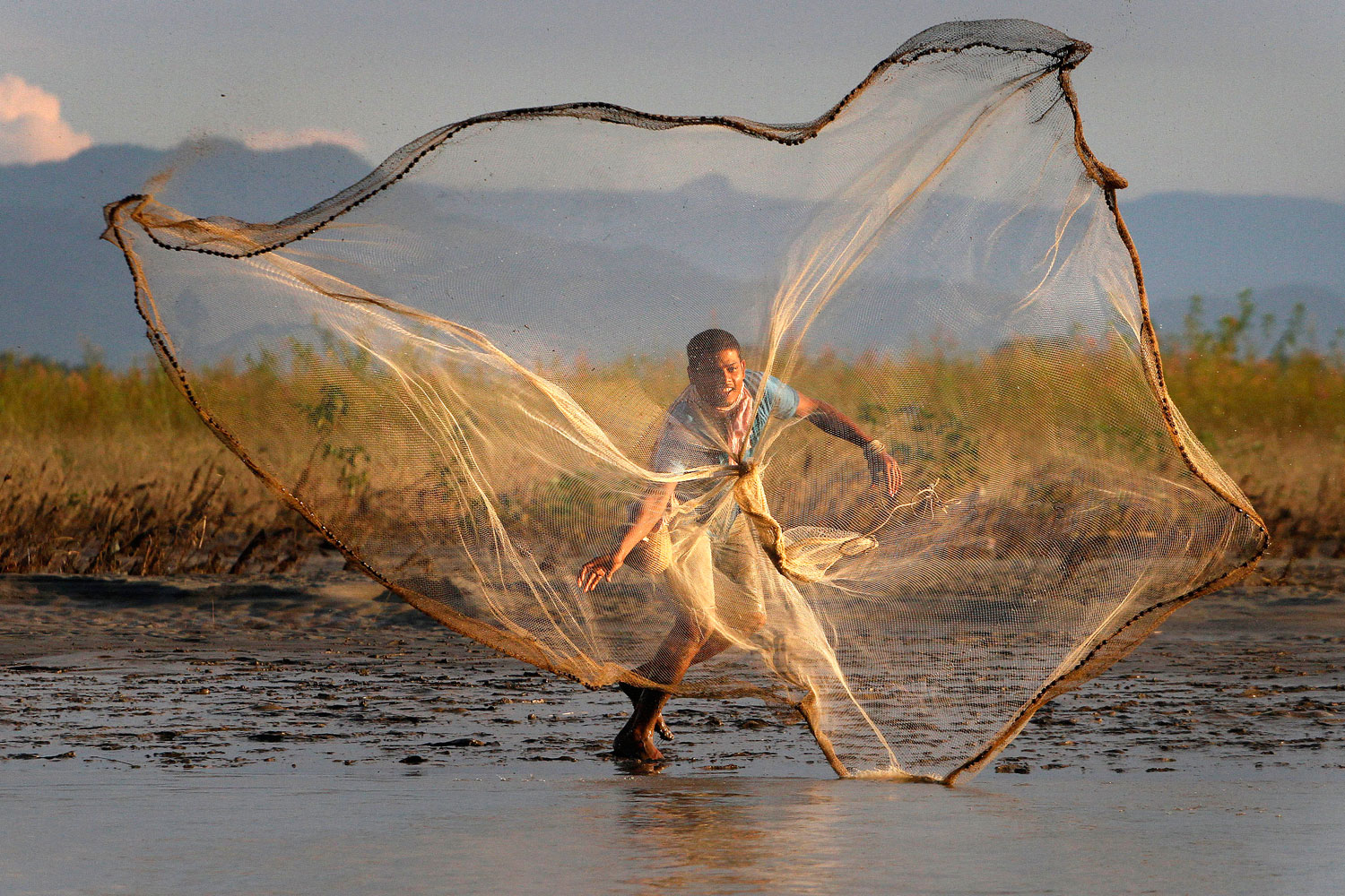 Aug. 30, 2011. An Indian villager throws a fishing net into the River Brahmaputra at Suwalkuchi, west of Gauhati, India.
