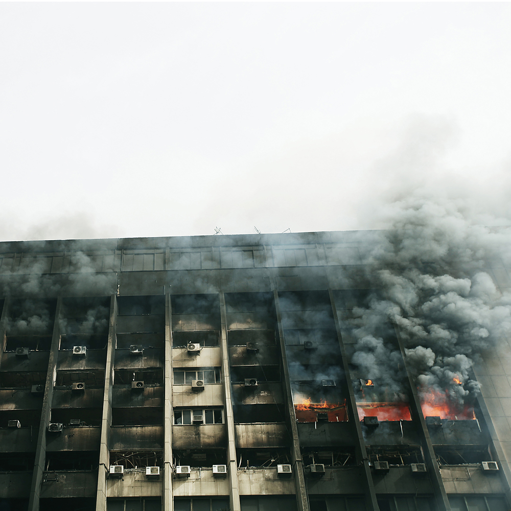 Myriam Abdelaziz spent the early part of 2011 documenting the protests in Cairo, Egypt. Millions of Egyptians took to to the streets to protest poverty, rampant unemployment, government corruption and autocratic governance of then-President Hosni Mubarak. Here, the NDP building on fire in Cairo, Egypt, Jan. 29, 2011.