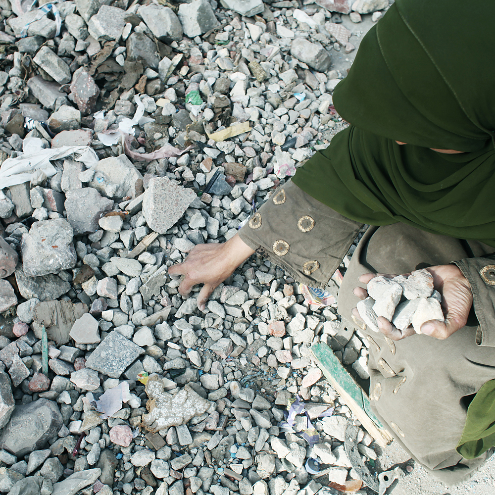 A woman collects rocks, Tahrir Square in Cairo, Egypt on Feb. 3, 2011.