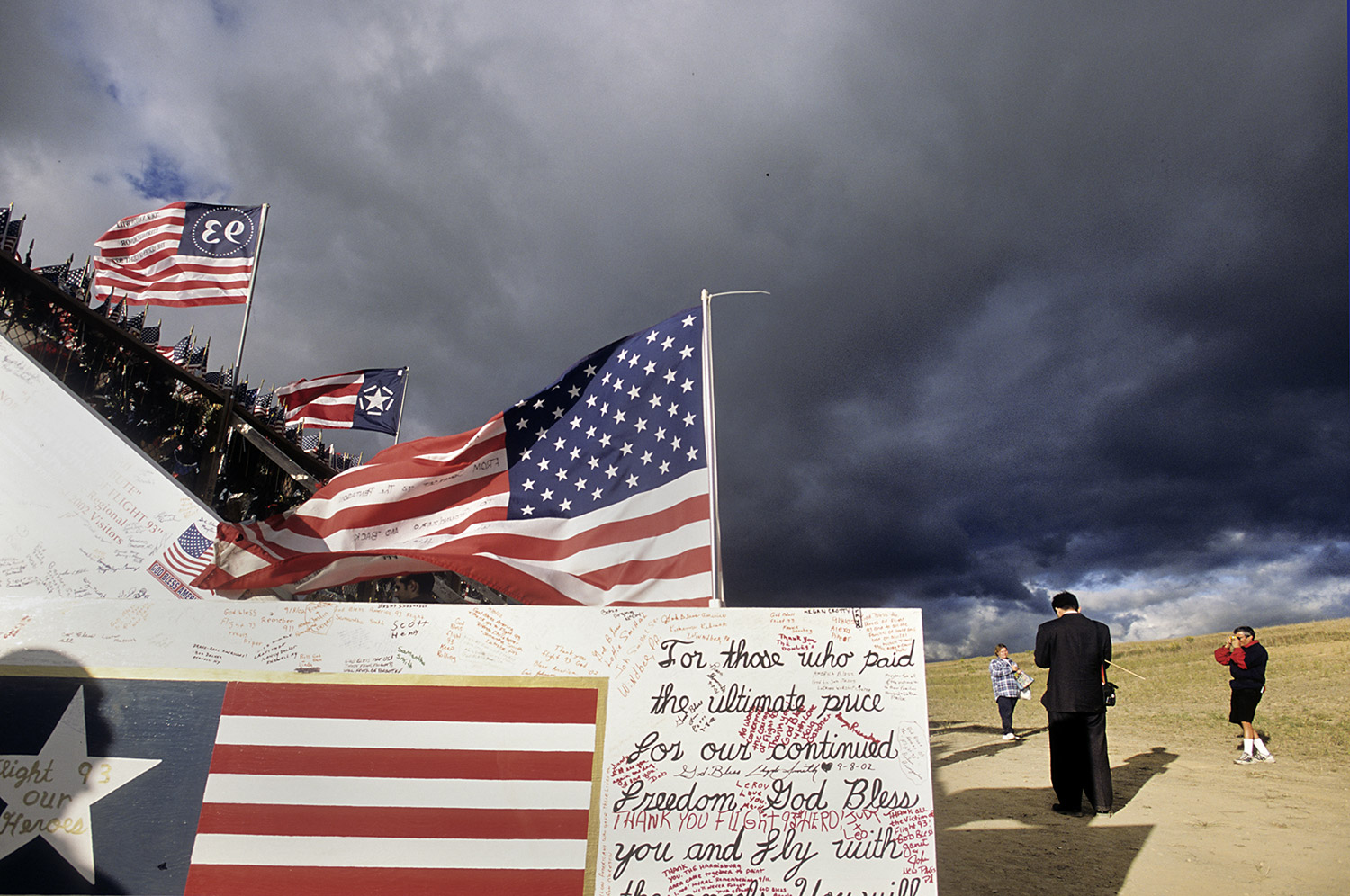 Flags lie in the temporary memorial for Flight 93 on the first anniversary of 9/11.