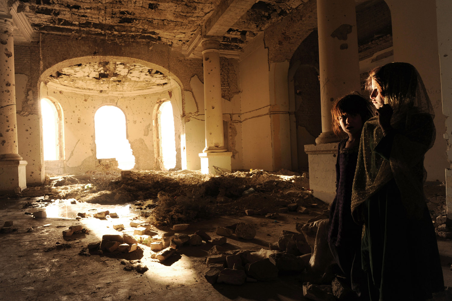 The nomadic Kuchi people seek refuge in the ruins of Darulaman Palace in Kabul, Afghanistan, after violent ethnic disputes with the Hazaras, October 17, 2010.
