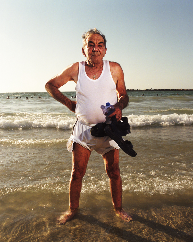 Yossi, 78, likes to come to the beach twice a day, at sunrise and sunset.