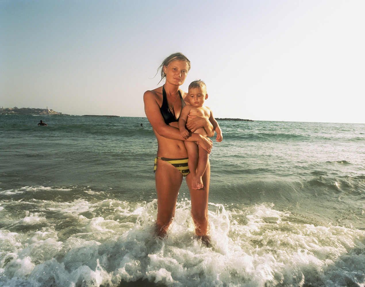 Elana with her son, whose favorite part of going to the beach is dipping his feet in the water.