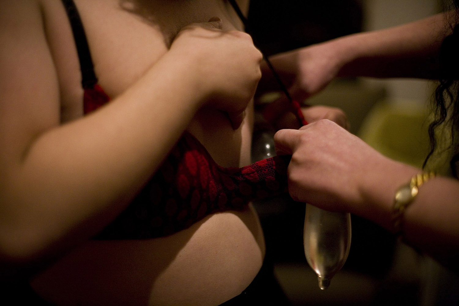 Pamela stuffs her bra with condoms prior to a drag show in Beirut in April 2010.