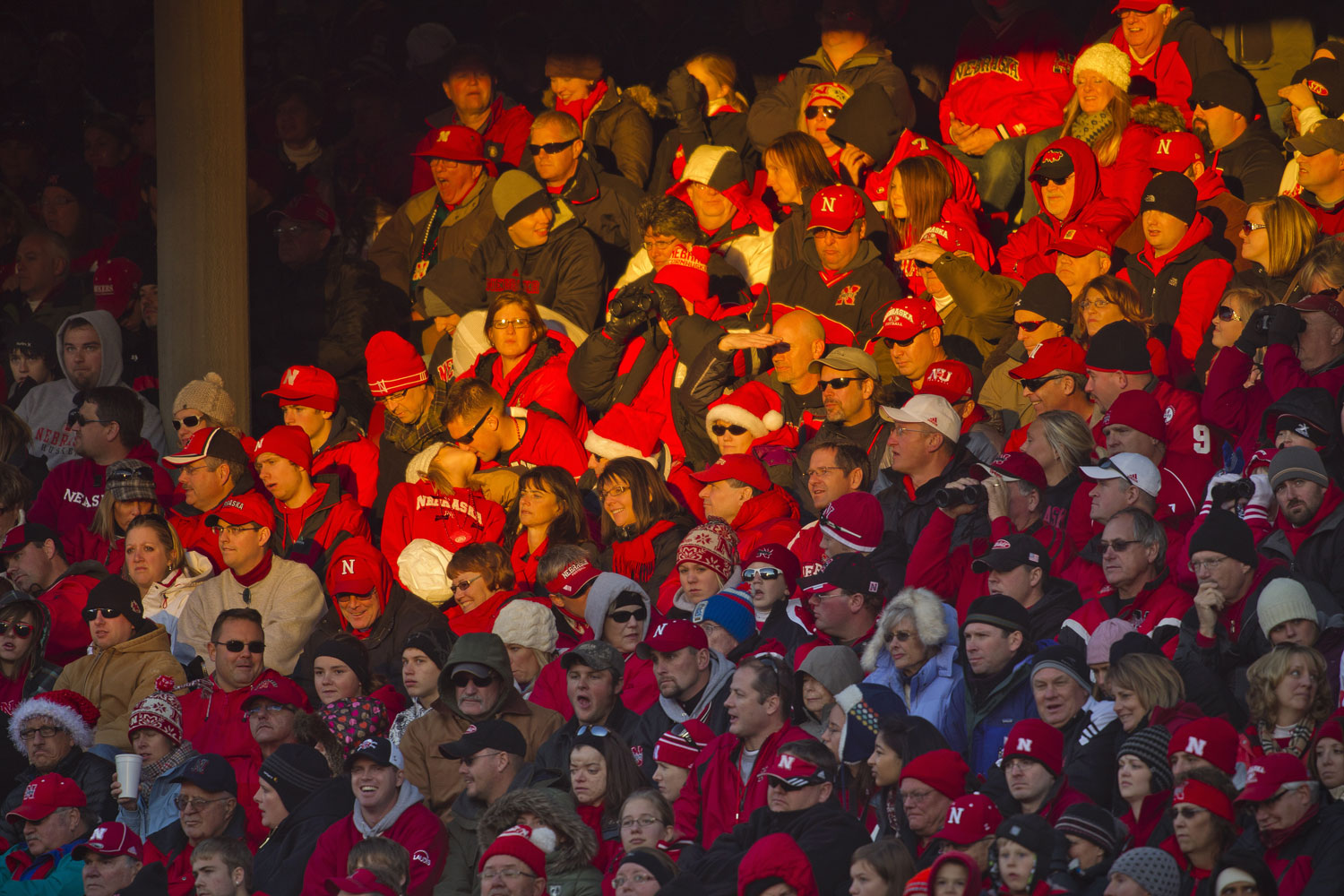 A couple share a kiss as the light fades at Memorial Stadium during a November 2010 game in Lincoln, Nebraska.