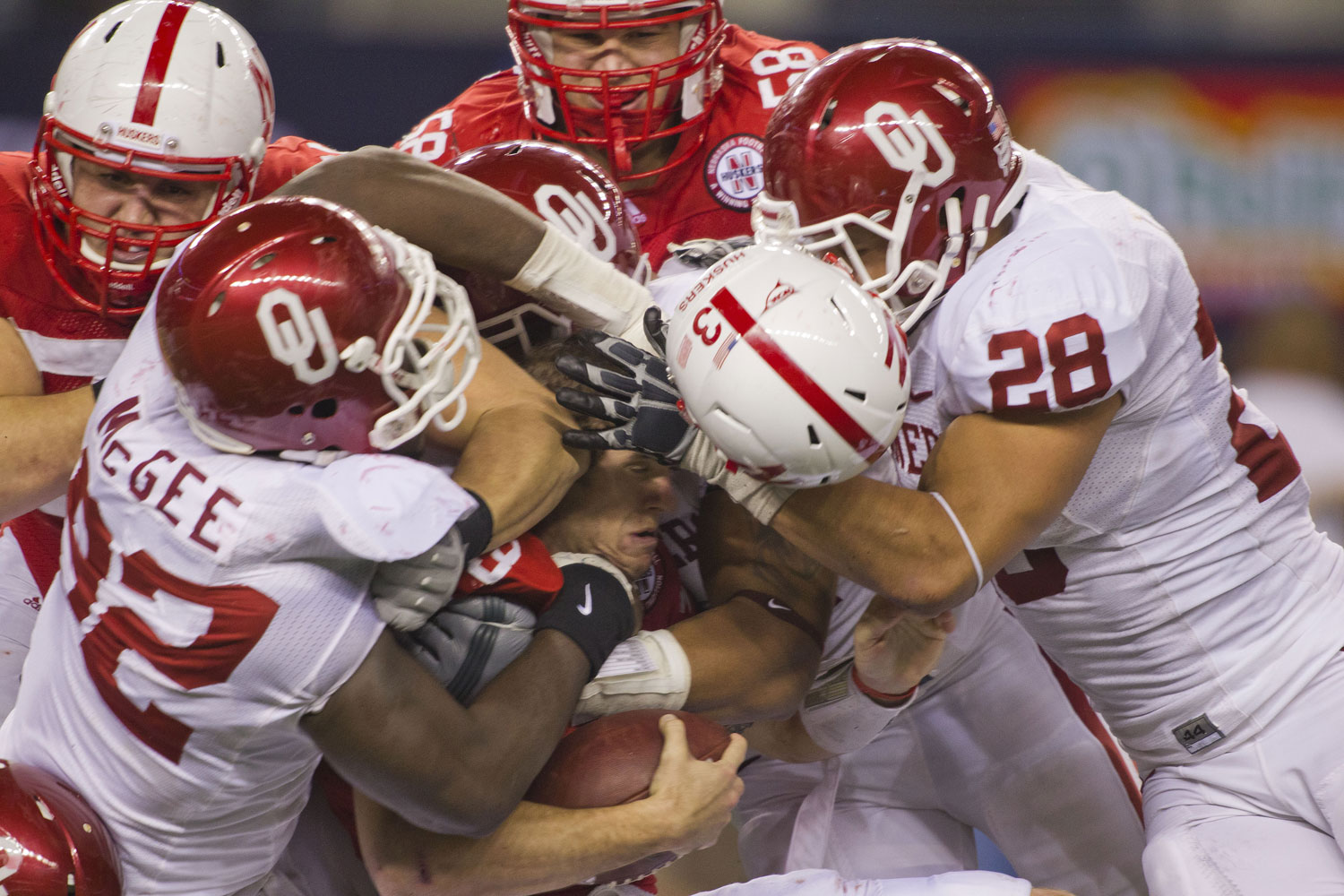 Husker quarterback Taylor Martinez nearly loses his eye, along with his helmet, during last year's Big 12 championship game against Oklahoma in December.