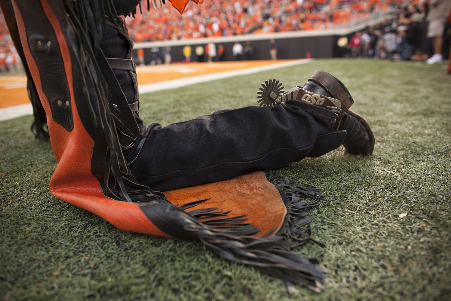Oklahoma State's mascot Pistol Pete takes a knee along the sidelines while the Huskers and Cowboys shoot it out during last season's October contest in Stillwater, Oklaholma.