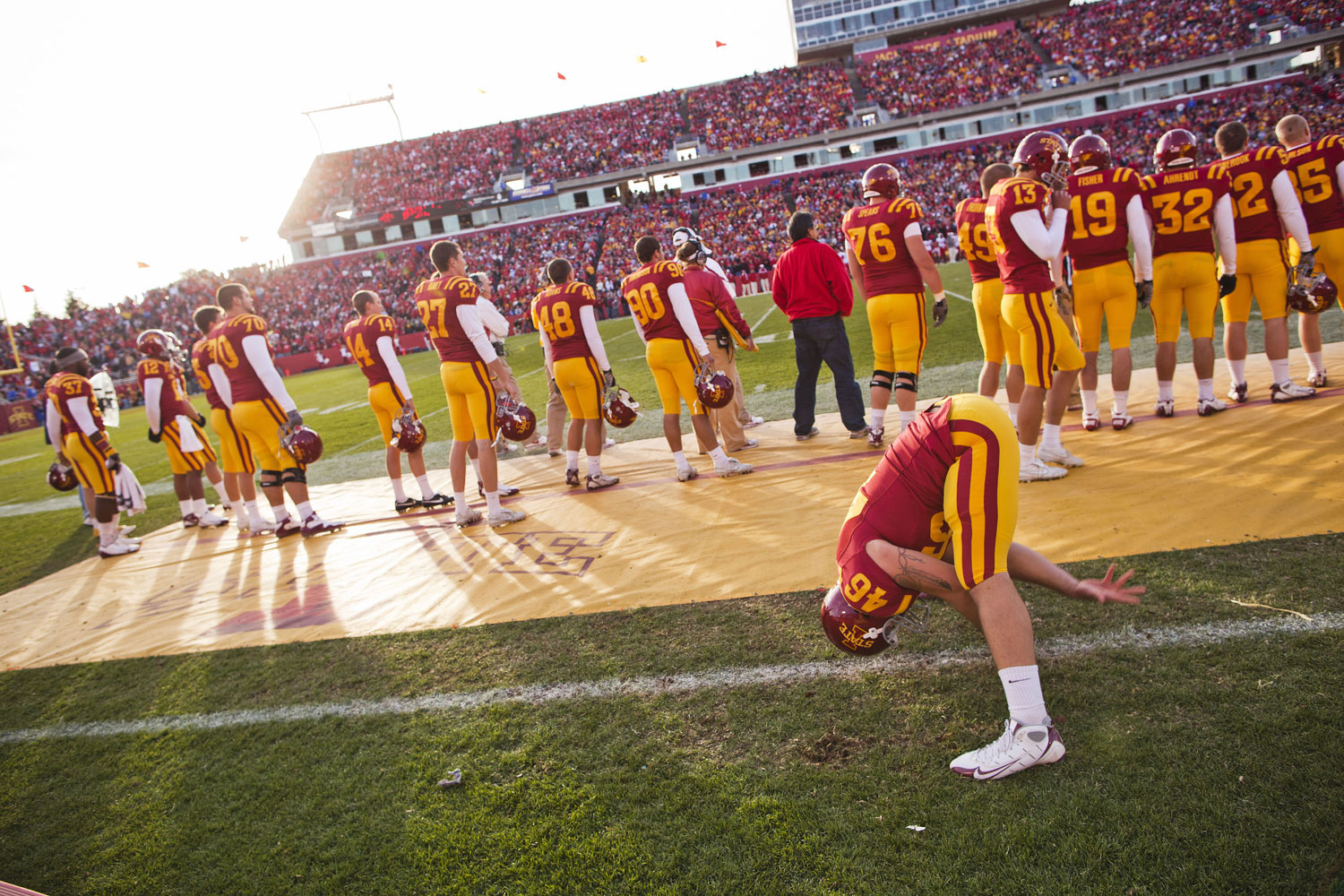 Iowa State's long snapper readies himself along the sidelines in preparation for a November 2010 game against the Huskers in Ames, Iowa.