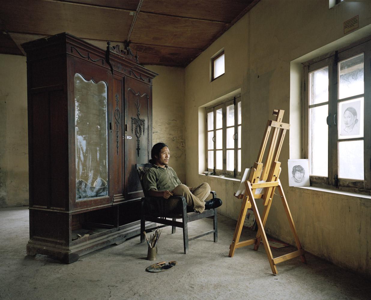 Karma Sichoc, a Tibetan Thangka artist, inside his studio in Dharamsala.