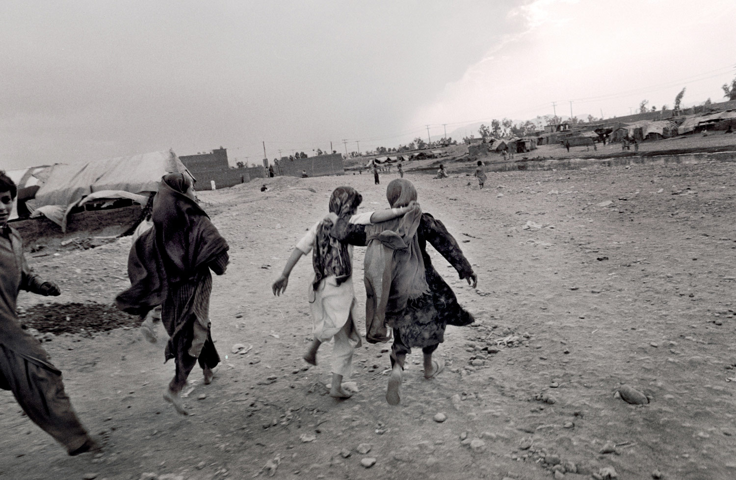 Afghans refugees in Peshawar, Pakistan, in 2001, as U.S.-led military action in Afghanistan was about to begin.