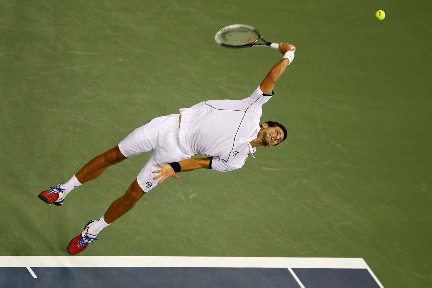 September 12, 2011. Novak Djokovic of Serbia serves during the final of the Men's Singles round at the U.S. Tennis Open in New York.