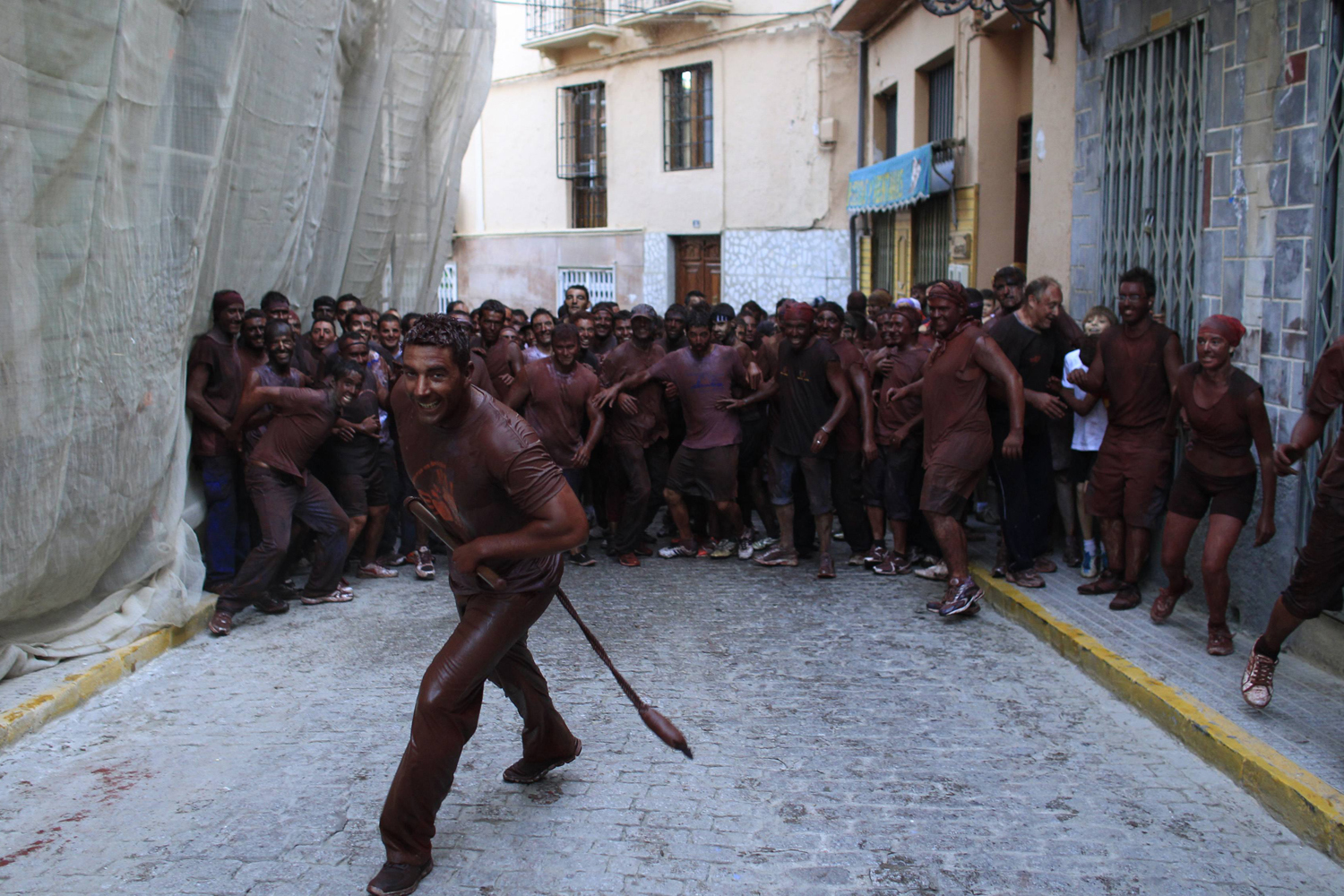 September 9, 2011. Revellers covered in paint take part in the annual  Cascamorras  festival in Guadix, Spain. The festival was inspired by a dispute between the villages of Baza and Guadix over the possession of the image of the Virgin of Piedad. The Cascamorras refers to representatives from Guadix, who are sent to the town of Baza to recover the statue. As the Cascamorras have to stay perfectly clean to gain possession of the statue, Baza residents attempt to make them as 'dirty' as possible.