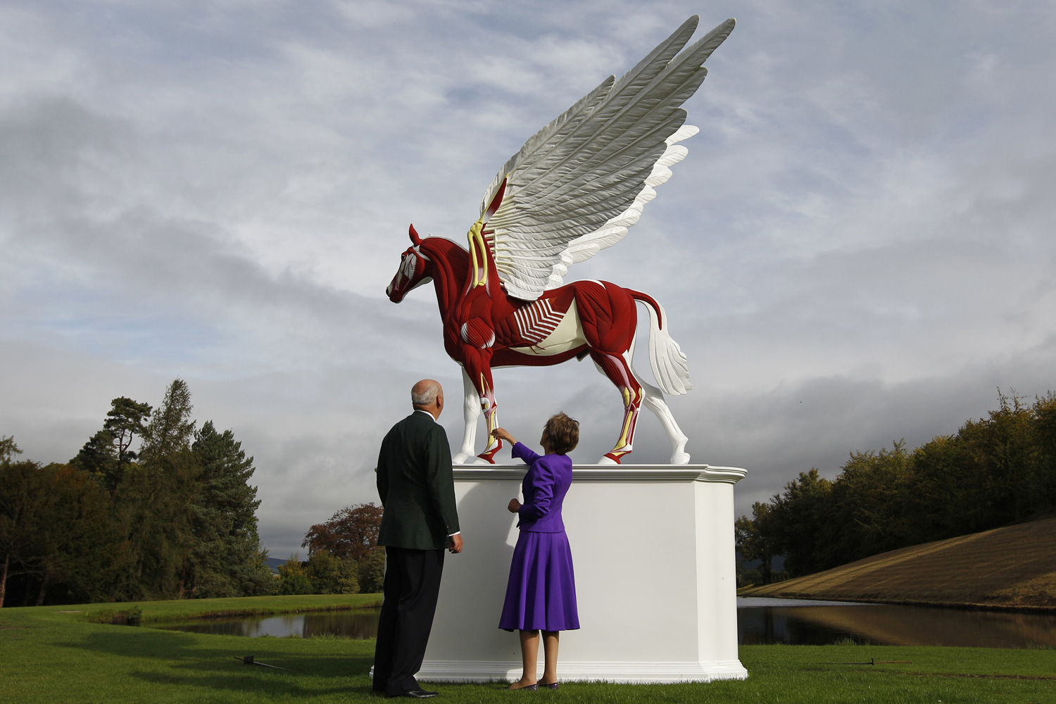 September 9, 2011. The Duke and Duchess of Devonshire view the sculpture Legend by Damien Hirst in the gardens of their home Chatsworth House in central England. The work is part of the Beyond Limits exhibition of modern and contemporary sculpture displayed in the gardens.