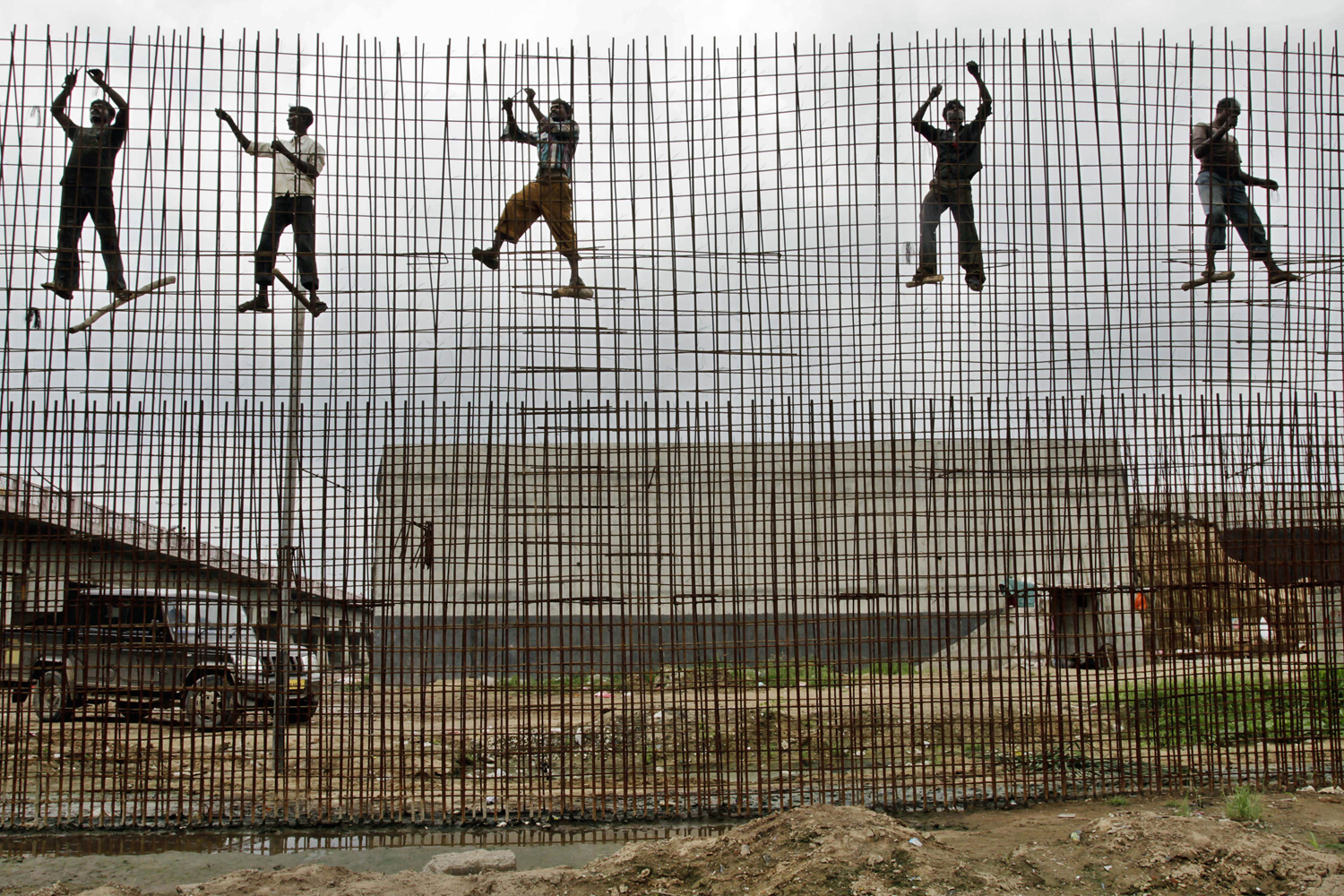 September 12, 2011. Indian laborers work at Sabarmati Riverfront Development Project site in Ahmadabad, India.