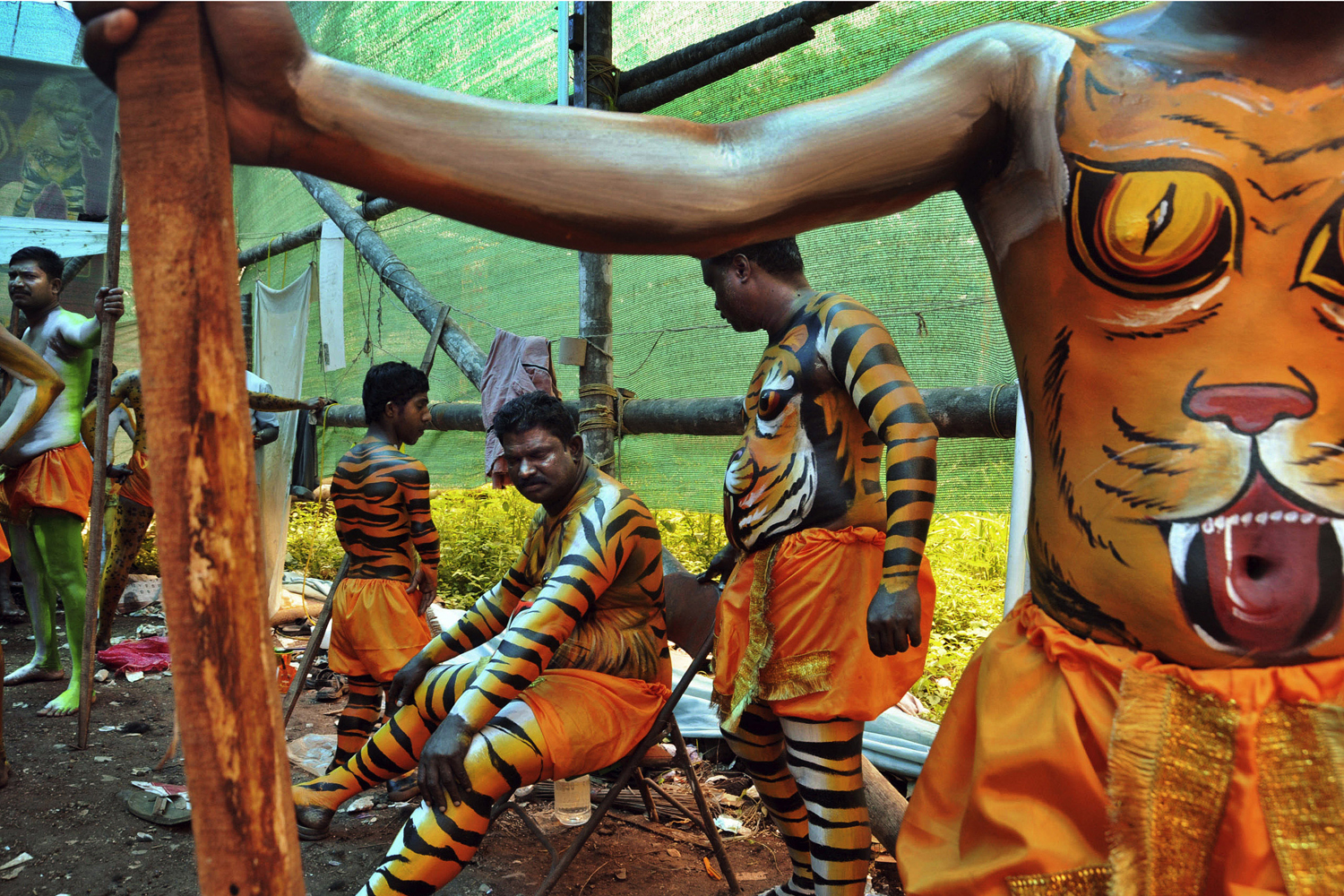 September 12, 2011. Indian artists with their bodies painted wait to perform at the annual  Pulikali,  or Tiger Dance, in Thrissur, Kerala, India. Participants with their bodies painted to resemble tigers and leopards roam the streets during this festival which falls on the fourth day of the harvest festival  Onam.