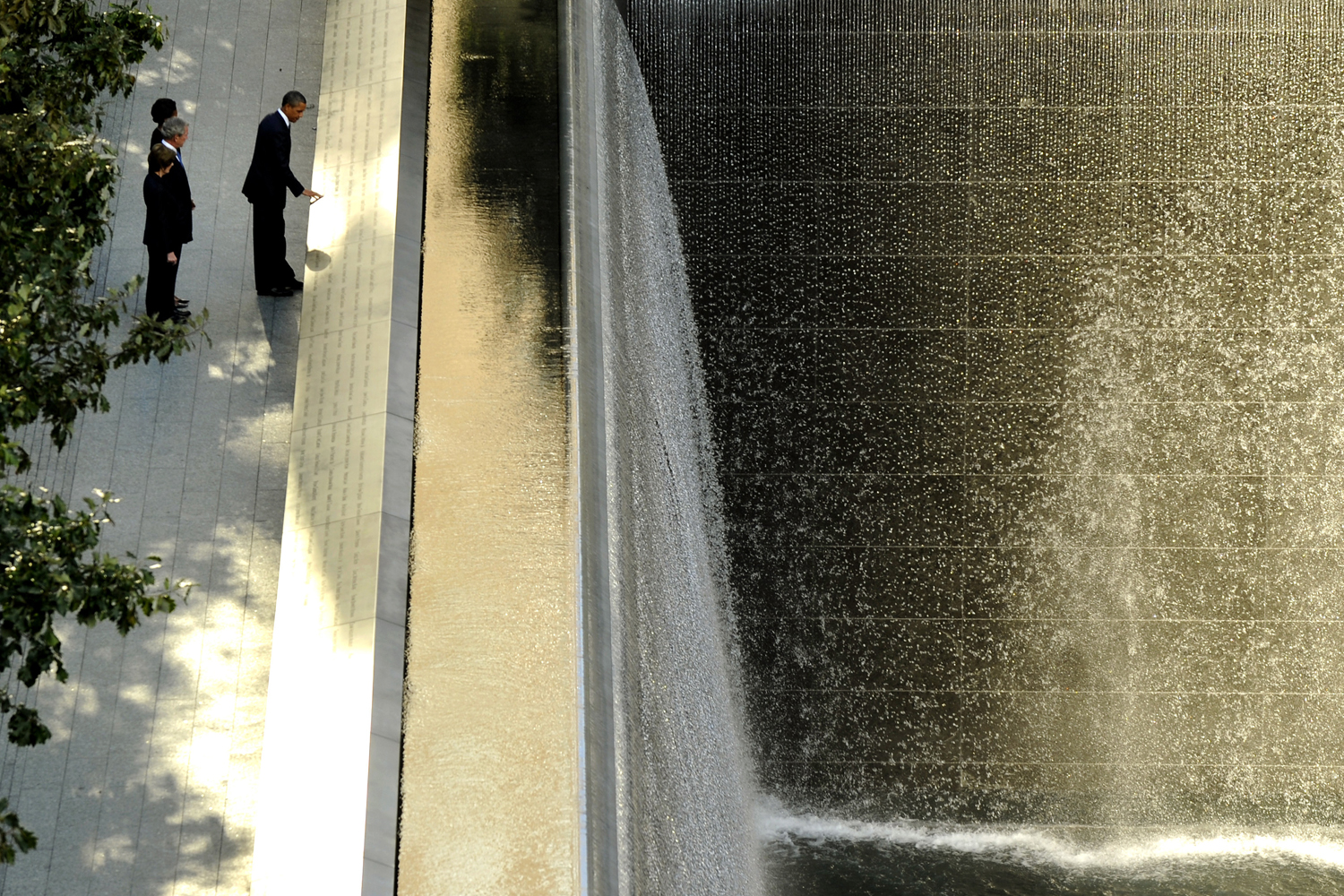 September 11, 2011. President Barack Obama, accompanied by his wife Michelle Obama, former President George Bush and his wife Laura Bush, by the South Reflecting Pool during a visit to the National September 11 Memorial in New York on the 10th anniversary of the terrorist attacks.