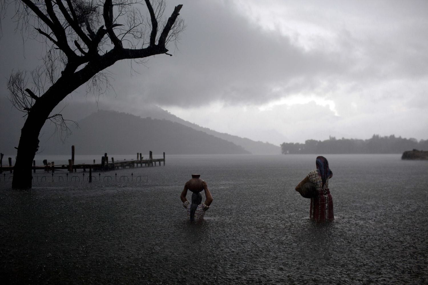 September 9, 2011. Sculptures of Mayan women are partially submerged in floodwaters in Santiago Atitlan, Guatemala. Guatemalans appear poised to elect former general Otto Perez Molina of the Patriotic Party as president in this week's election.