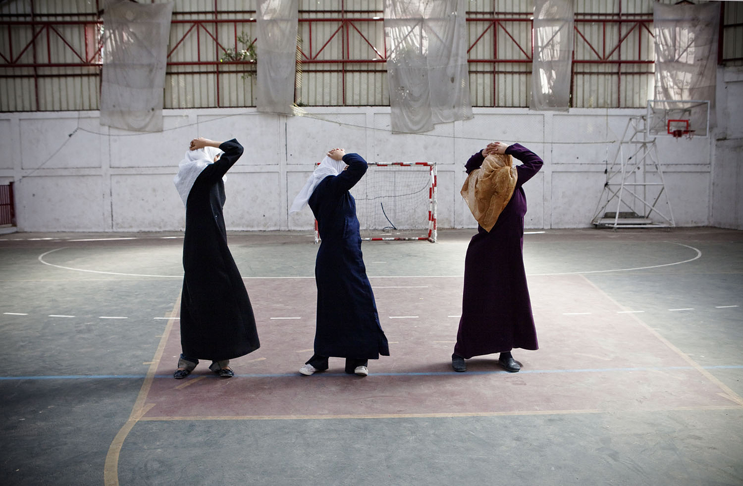 Tanya Habjouqa's recent work documents the everyday lives of Palestinian women in the Gaza Strip. Here, young women exercise in gym class at their school, where the Women's Charitable Society helps organize activities for them in Gaza, Oct. 28, 2009.