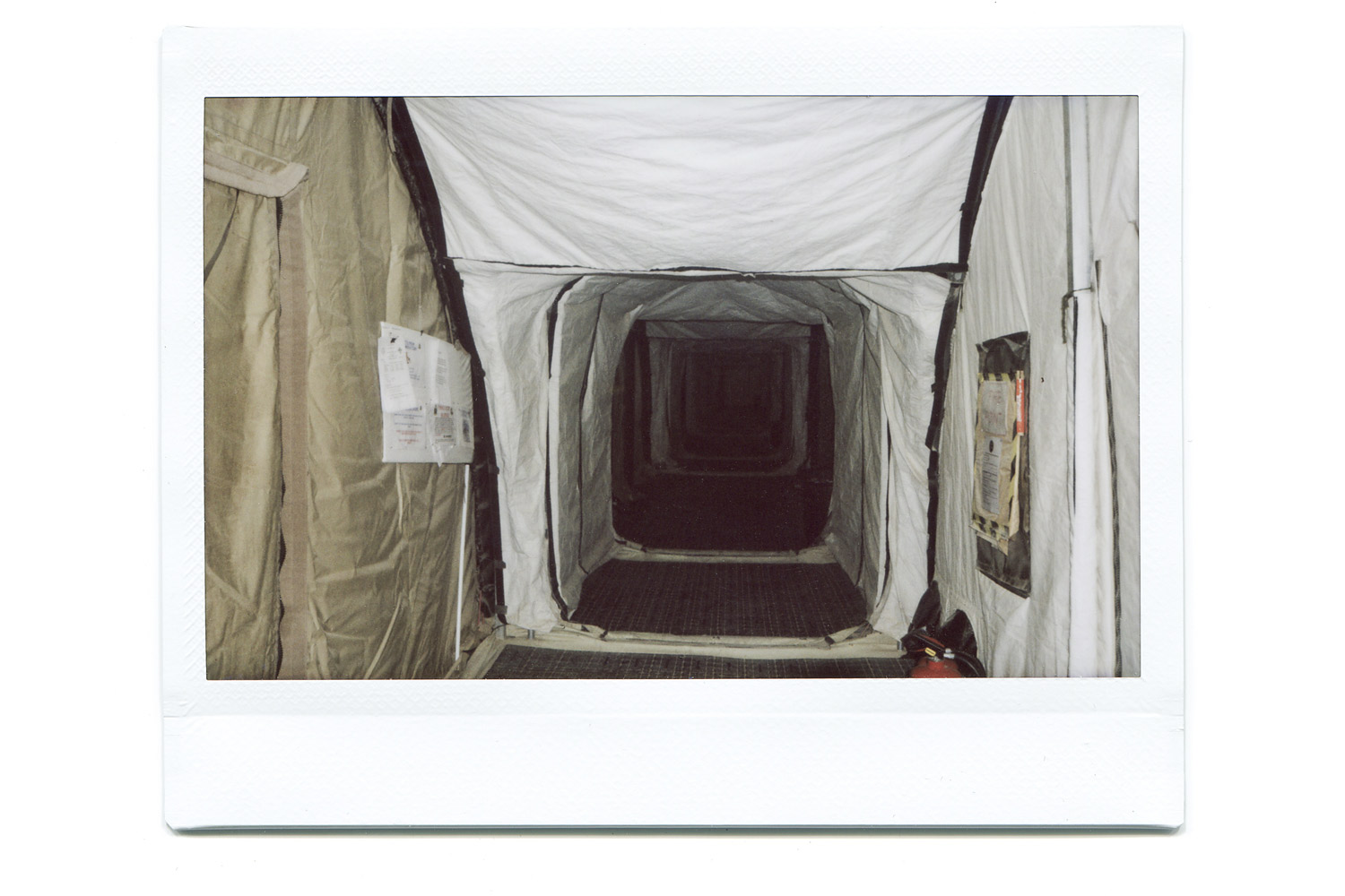 A corridor in tented accommodation.  Walked through here many times a day, liked the way it looked like a tunnel so decided to shoot it.