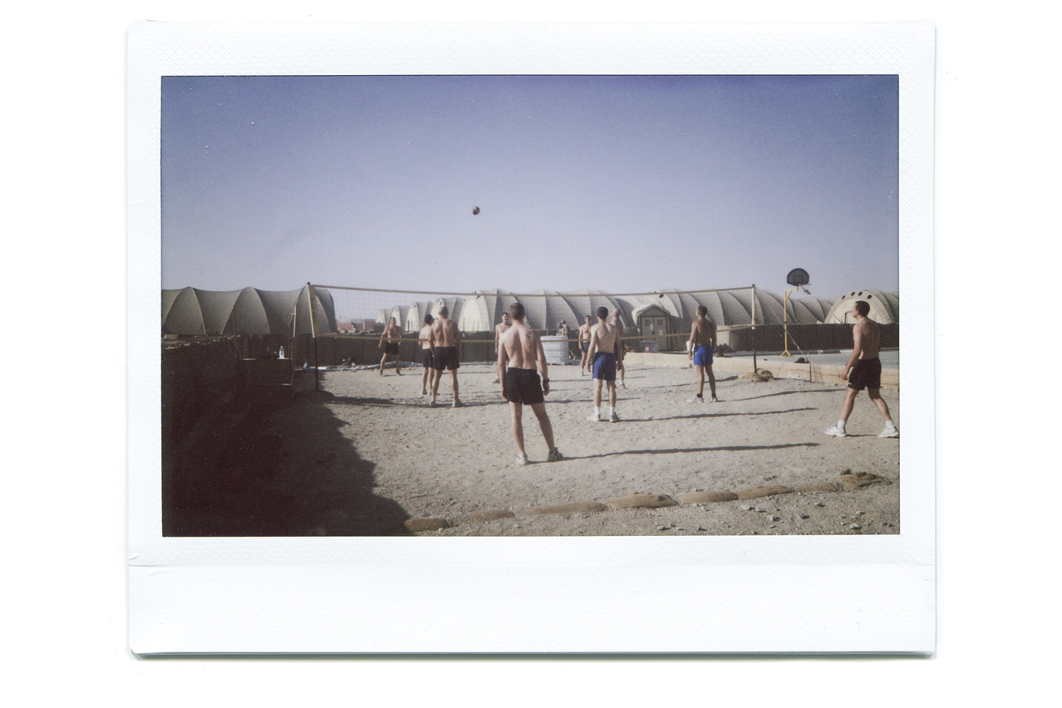 Matt's friends play volleyball during downtime. It seems alien to have such a normal activity in such a hostile country.