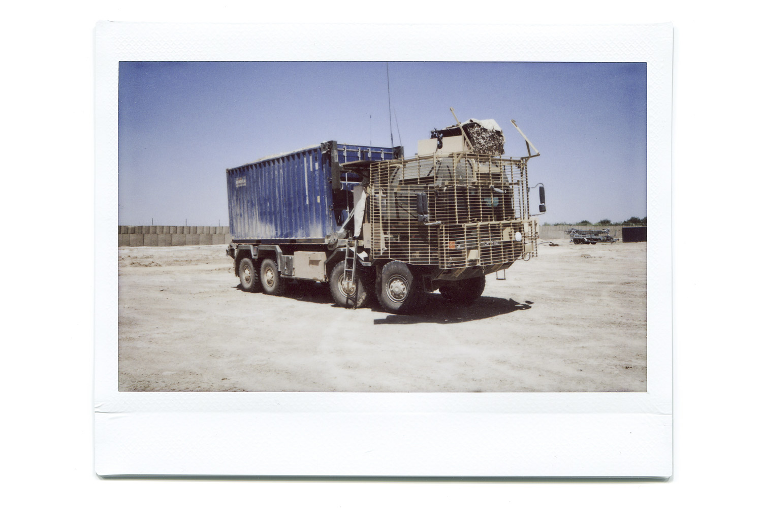 A military container-carrying vehicle.  These vehicles would carry vital supplies to the bases around Helmand. We were responsible for providing medical support should anything go wrong. I liked the colors.