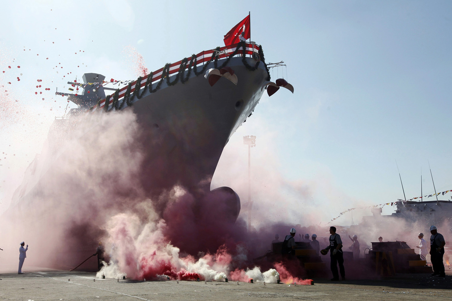 September 27, 2011. Workers and officers attend the launch for the second nationally designed combat ship TCSG Buyukada, at the Tuzla Naval shipyard in Istanbul.