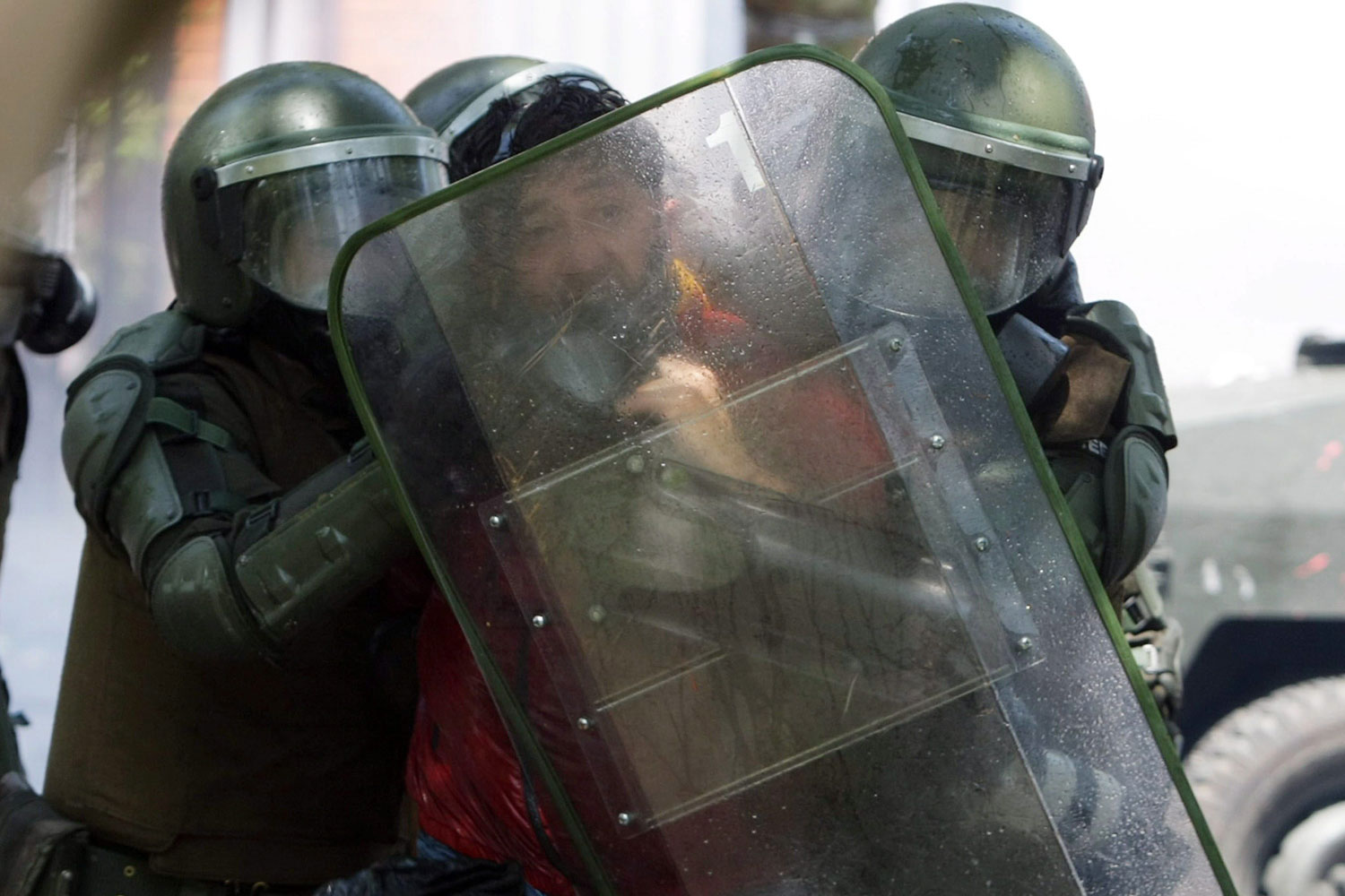 October 18, 2011. Agence France Presse photographer, Hector Retamal, is arrested by police during a protest in Santiago, Chile, on the first day of a new national strike called by students, that was described by government as a  complete failure.