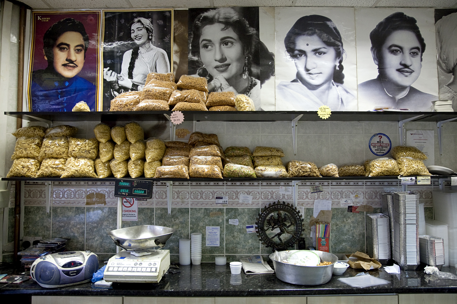 The Hindu owners of the Sweet center, one of the many sweet shops on Soho Road, are Bollywood fans.  Posters of Indian film and music stars are draped around the shop alongside Hindu statues.