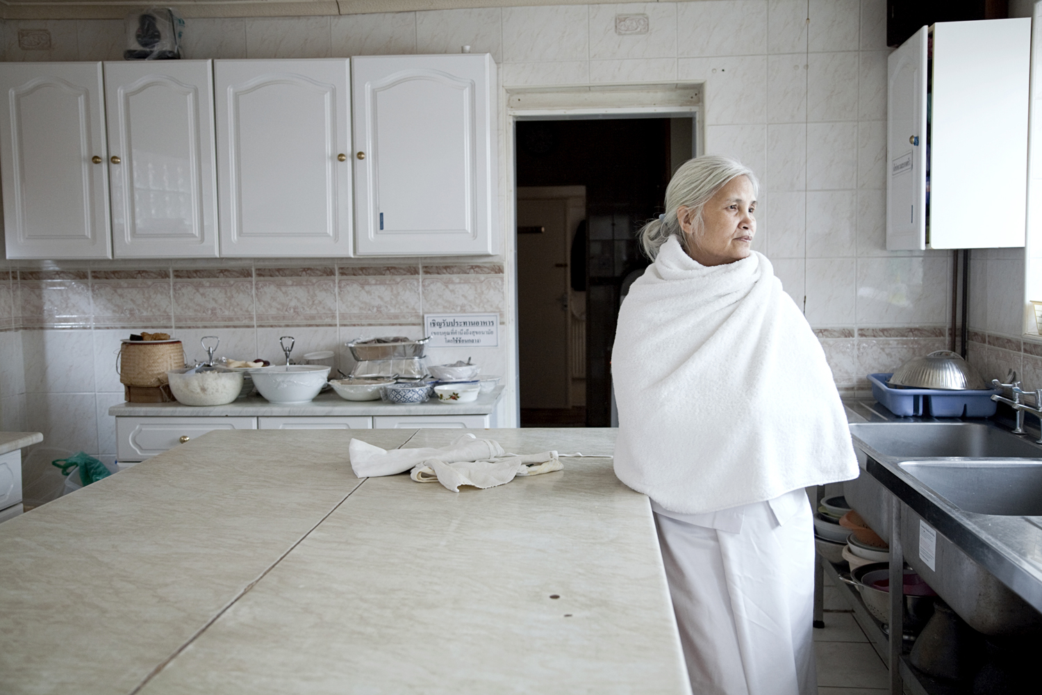 'Preacher' stands in the kitchen of the Thai Buddhist temple she established close to Soho Road in the 1970s. She owned the first Thai restaurant in Birmingham before she became a Buddhist nun, purchased the temple and brought monks over from Thailand.