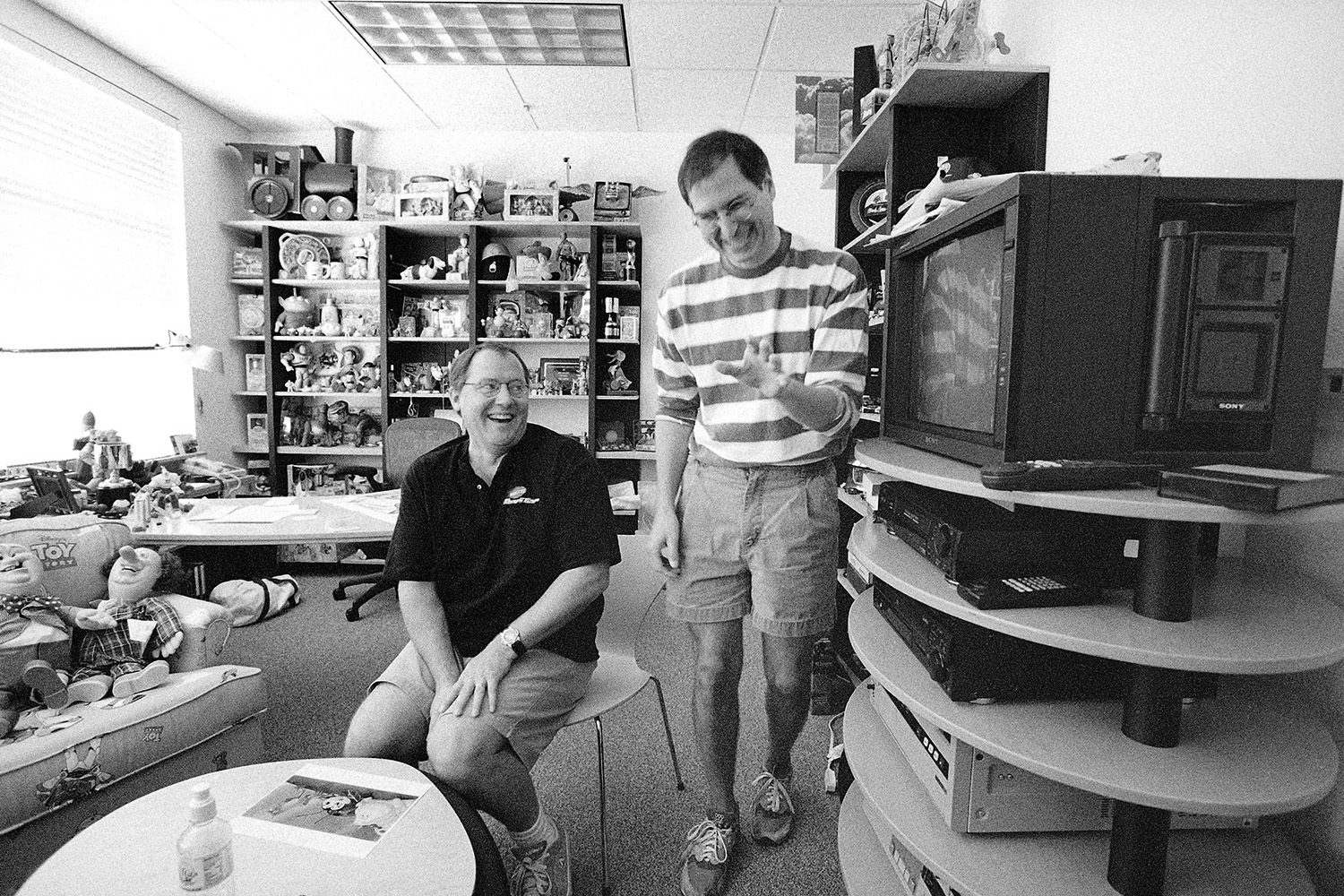 Jobs has a laugh with John Lasseter of Pixar in the animation studio's headquarters.